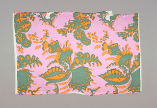 "Fragment printed in pink, green and orange. Pattern shows large scale swirling ""bizarre"" design of wings and floral elements."
