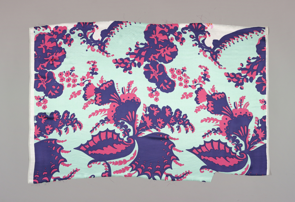 """Fragment printed in aqua, dark blue and red. Pattern shows large scale swirling """"bizarre"""" design of wings and floral elements."""