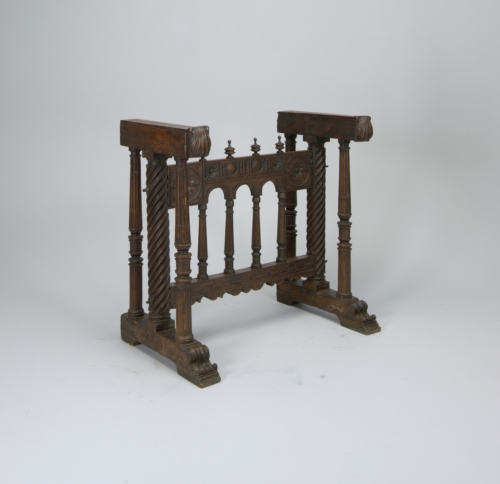 Trestle stand with turned supports and carved, arcaded stretcher having four baluster-form collumns with turned finials. (Stand for Vargueño 1968-140-7.)