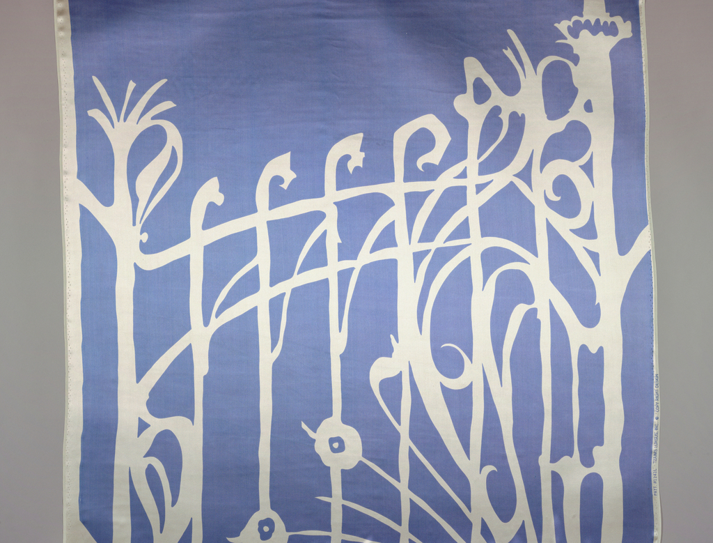 Printed in blue against white background. Pattern shows asymmetrical outline of wrought iron gate.