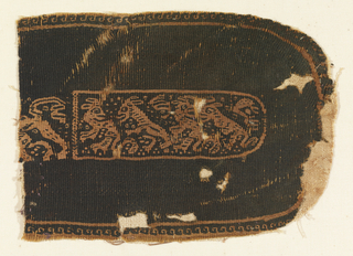 Shape with one oval end. In the center a procession of spitited animals.