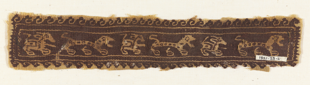 Narrow band fragment in dark brown and natural linen shows a procession of animals moving left to right. The animals, which alternate between a long-bodied spotted animal and a more compact animal with long ears and a tail, are enclosed by a double guard border. Outside this border is a scrolling wave pattern.