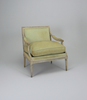 Open-armed, wide chair (a); rectangular back, blue-and-gray painted frame carved with twisted ribbon band and bead-and-reel band; arms terminate in scroll and acanthus leaf; acanthus leaf on knees; stop-fluted legs with rosette in square on two sides above each front leg.   X in square on two sides above each rear leg.  Boxed back, arm rests and loose seat cushion (b) upholstered in light blue velvet.