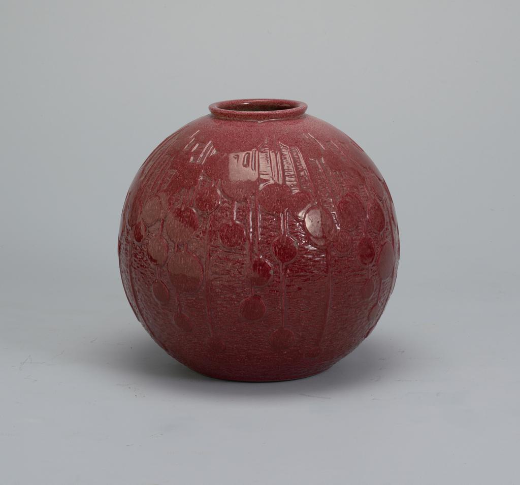 Globular vase with raised circular and linear decoration; raspberry red glaze.