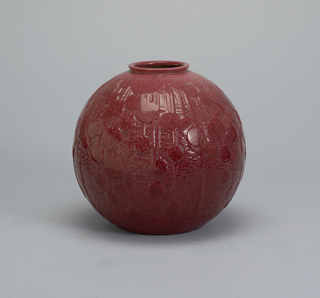 Globular vase with raised circular and linear decoration; raspberry red glaze.
