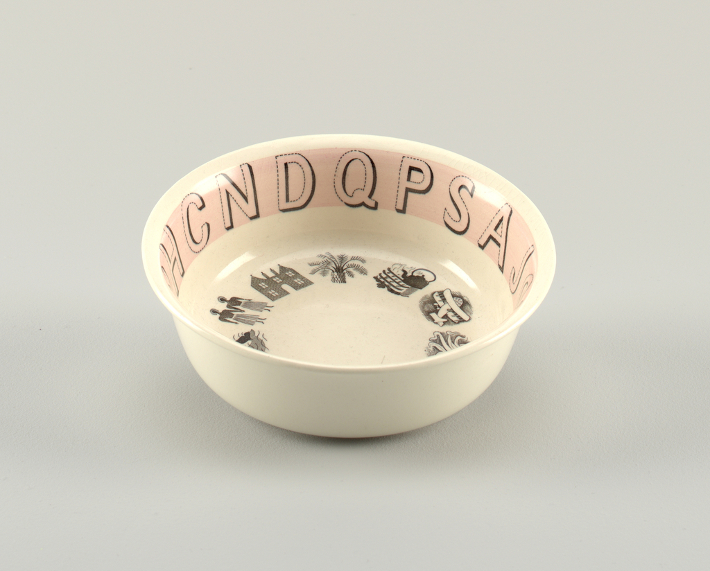 A white circular bowl. The inner side has a thin stripe of pink with the alphabet around it in black outline. The bottom of the bowl has a circle of small images including a plane, octopus, mountain, pear, duck, whale, two figures, building, palm tree, and a kettle on a stove.