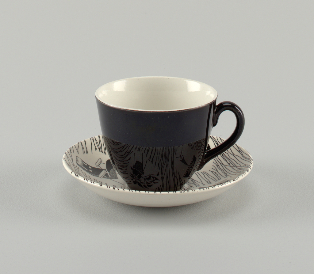 Cup (a) with curved sides flaring to plain lip; exterior glazed in solid black; interior glazed white. Saucer (b) concave with depressed center for cup; white ground printed with black irregular lines and five vignettes in black with furniture, kitchen tools, etc.