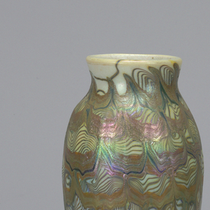 Urn shaped vase, with abstract striated multi-colored iridescent glaze decoration.  White background. Glaze is blue, purple, apricot, green and gold.