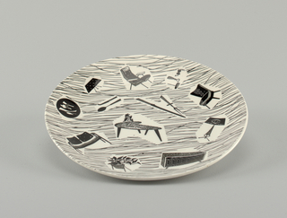 Circular concave plate; white ground printed in black with irregular lines and eight vignettes of furniture, kitchen tools, etc.