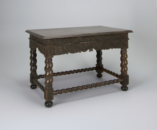 hardwood table with spiral turned stretchers and carved apron. Dutch East Indies for the European market.