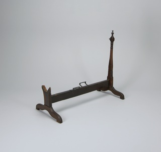 Self-rocking cradle, with metal fixtures a: Cradle, b: Stand, c: Rocking Mechanism