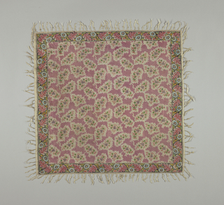 Kerchief or square with a pink ground containing scalloped forms, each containing stylized multicolored floral spray on a dotted ground. Narrow floral border on four sides. Silk fringe knotted at one inch intervals.