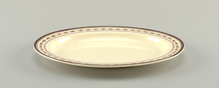 Dish semi-ovoid with raised ends, on elliptical foot. Tray elliptical, with flat marly. Ladle semi-spherical with curved handle and scrolled end. Borders of brown husk decoration, with dotted and solid bands.