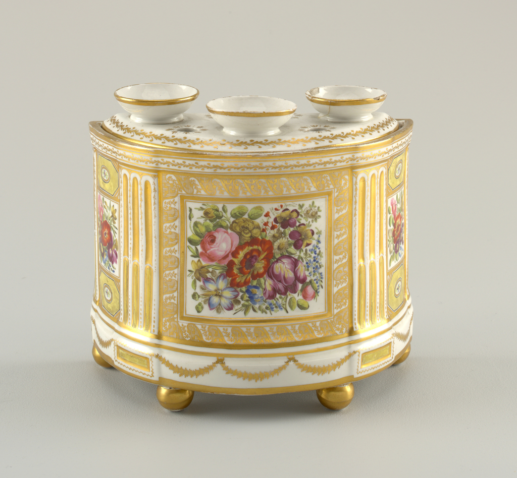 Semi-cylindrical, on four ball feet. Straight-sided back undecorated; bowed front divided into three panels, by pilaster strips. Rectangular reserve in each panel, containing flowers. Cover with three cup-shaped rings around openings, and four circular piercings.