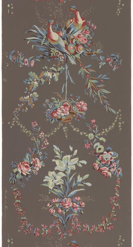 Bouquet of lilies and roses set within floral swags, alternating with two doves perched on branch.