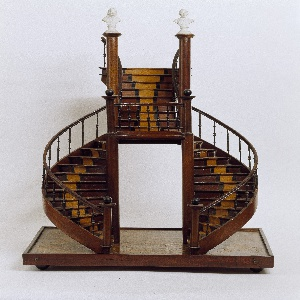 ... Model of a curved double staircase reaching a landing and continuing up  as a single stair
