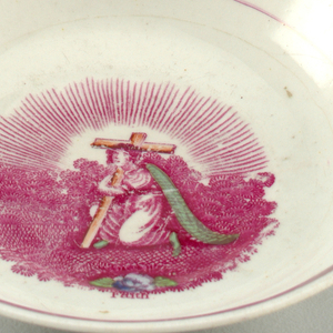 Two saucers with pink lustre banding and pink transfer-printed figures of Faith, Hope and Charity.