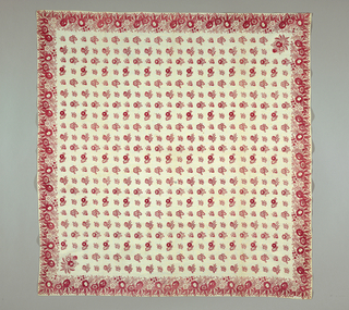 Square printed in small, scattered reddish-pink floral pattern on a white ground. Floral border with two larger bouquets in two opposing corners. Carefully hemmed on all sides.