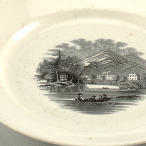 White plate with central decoration showing four boys in a boat, with mountainous landscape behind.