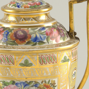 Semi-ovoid, with domed top, raised strap handles and square base. Geometric design on body with square reserve on front, containing flowers. Floral bands about foot, foot bolted to body, top and cover. Gilding throughout.