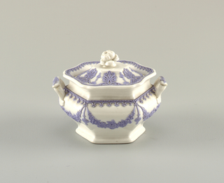 Hexagonal bowl with bowed sides. Outcurving rim and foot. Two molded handles. Decoration of flower garlands pendant from pearl-and-scroll border. Cover has rose-shaped knob handle and palmette decoration.