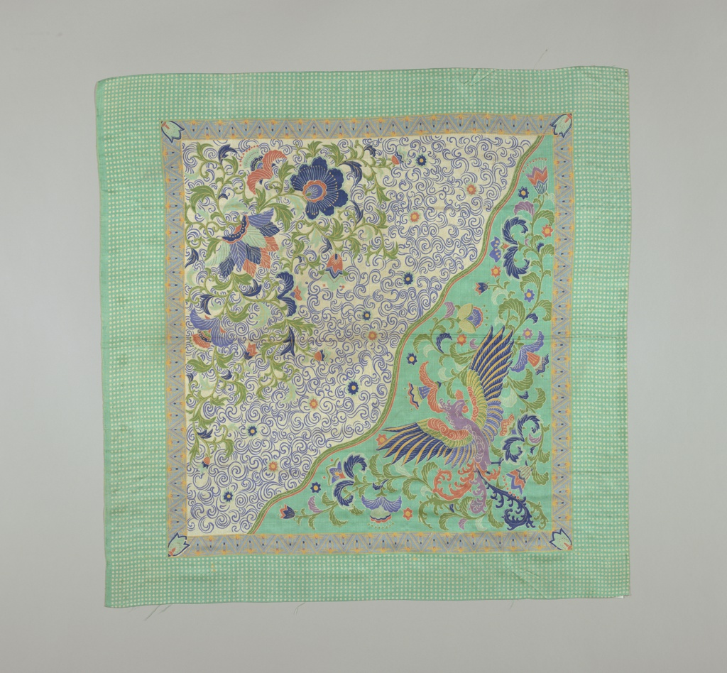 Square divided diagonally with exotic bird on one side, exotic flowers on the other. Border of white dots. Elements of the design are similar to the work of the Ballets Russe.