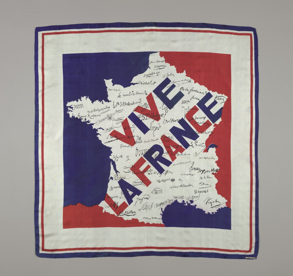 """Silk square with """"Vive la France"""" in large blue and red letters and signatures of noted French citizens in black on a white ground in the shape of France. Surrounding areas are filled with red and blue. Deep white border with narrow red and blue border on the outer edge."""