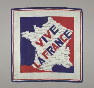 "Silk square with ""Vive la France"" in large blue and red letters and signatures of noted French citizens in black on a white ground in the shape of France. Surrounding areas are filled with red and blue. Deep white border with narrow red and blue border on the outer edge."