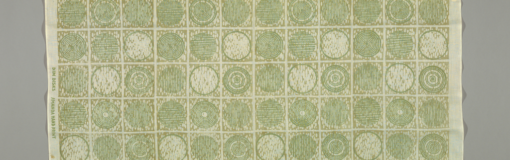 Design of circles inside squares form regular columns and rows. Squares have a background of densely clustered ovals. Circles are either empty, revealing the background pattern, or are filled with horizontal, vertical or concentric lines. Printed from blocks cut by the designer in shades of green.
