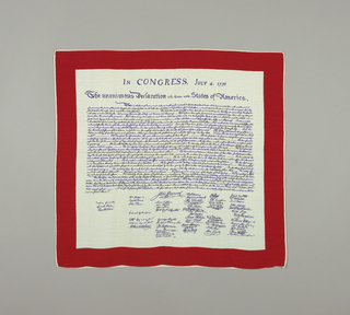 Handkerchief with a red border and blue text has the Declaration of Independence with signatures below.