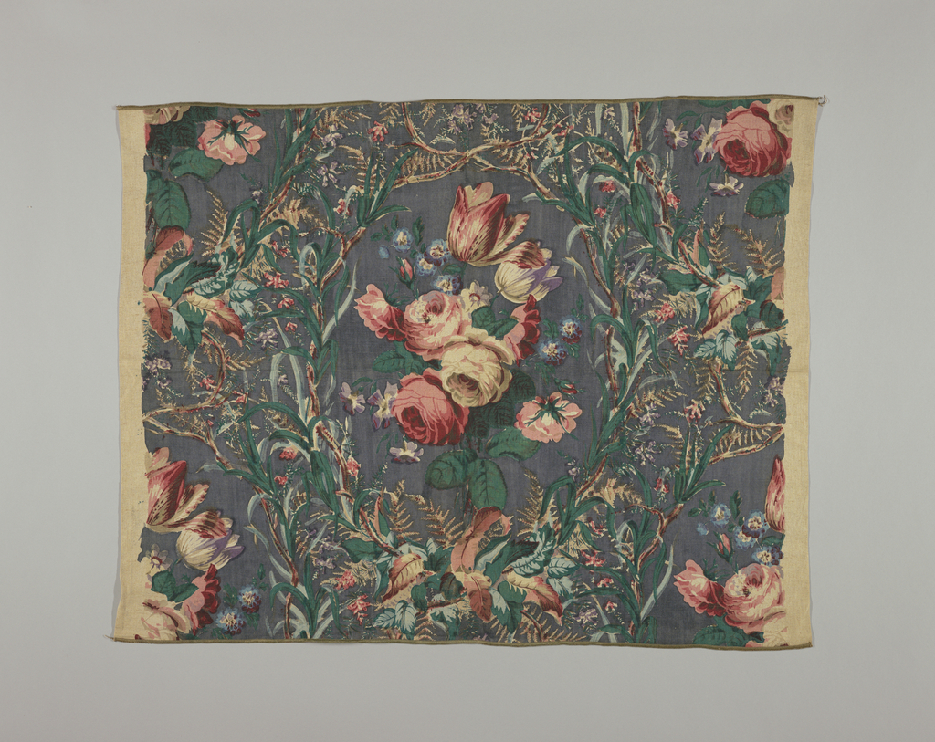 Polychrome block print on dark grey linen. Lattice of greens, brown vines and small flowers. Oval frames large cluster of flowers in red and pink roses, tulips, blue flowers. Clusters of flowers in one-half drop repeat, continuous lattice work.