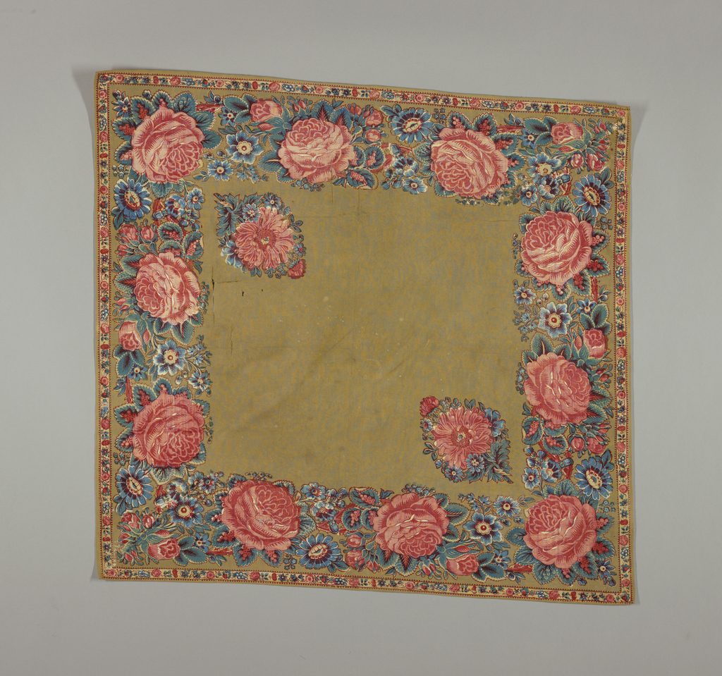 Square kerchief with brown ground and a border with large roses and other smaller flowers in blue, yellow and red.