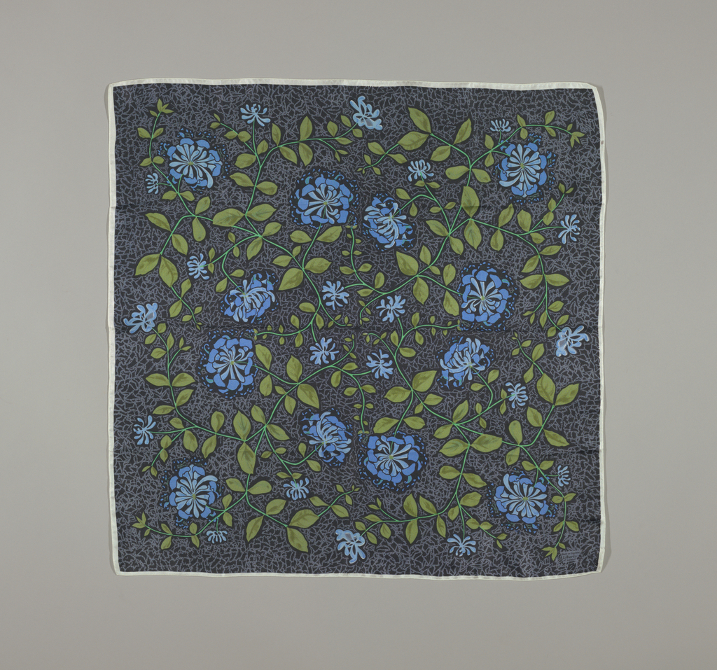 "Square scarf in blues and greens on a dark blue ground. Pattern adapted from ""Honeysuckle"" by William Morris."