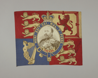 Central medallion with a picture of King Edward VII. The top left and bottom right corners have three lions, the top right has a lion standing on it's hind legs, and the bottom left has a harp. Printed in red, blue and tan on undyed fabric.