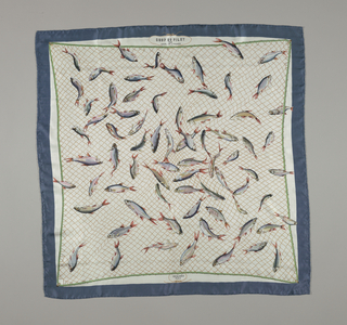 Square scarf with a blue border and white field with design of delicately colored fish in an orange net.