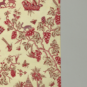 Grape vines form a lattice enclosing a pagoda by a palm tree, and other chinoiserie motifs. Printed in two shades of red, purple and green on a white ground. Reproduction of an earlier style possibly by Oberkampf.