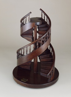 Double staircase model with double revolutions and banisters.