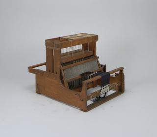 16-harness loom with beater and loom stand.