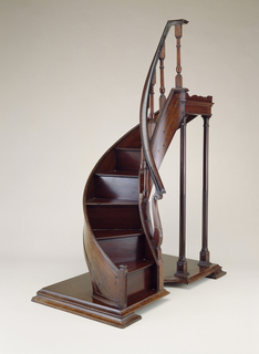 Slightly semi-circular staircase model with banister.
