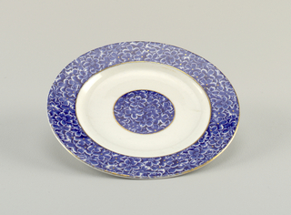 Two plates with blue floral marli and center medallion on white ground.
