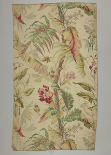 Multicolored block print on natural linen. Large tropical tree with large green leaves, red and pink flowers, and red and grey flowers. At sides are parts of a calla lily plant.