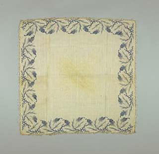 White muslin square kerchief with a looped edge. Blue border design in a pattern resembling seaweed and coral.