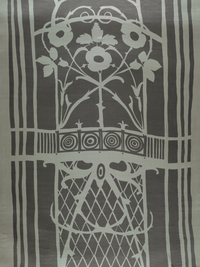 Printed in grey against white.  Pattern shows symmetrical iron gate with central rose pattern enframed by geometric linear shapes.