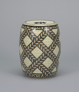 Cylindrical with swelling sides, flat open base, flat top. Molded overall with woven wicker pattern in relief, and with flat crossed bands painted to resemble mosaic inlay in black, gray, brown, blue, and green. Wicker sections left white, with clear glaze. Top pierced in center with three holes within circle to form hand grip.