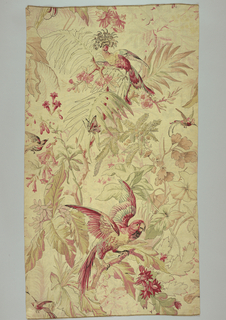 Polychrome block-print on natural linen. Two central motifs, one on top of other: parrot in reds and green with spread wings stands on branch of jungle foliage. Other motif: exotic bird with full crest, in reds, yellows and greens, on branch jungle foliage. A smaller butterfly and colorful birds fly about. Vertical repeat almost complete; side to side repeat matches at a 1/2 drop. Condition: soiled.