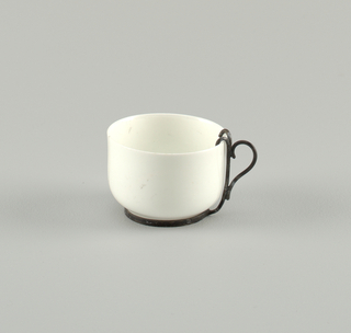 Porcelain cup with metal handle. 1962-149-1*