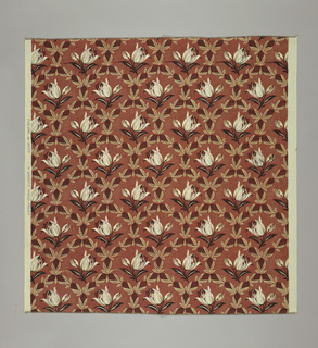 Reproduction-style fabric of tulips set within a diamond-shaped lattice of leafy cones in dark red, black and tan.