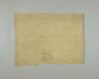 Fragment of a lining fabric. inventory stamp showing a crowned oval. interior of oval may contain a side view portrait. there is undecipherable writing around the edge of the oval.
