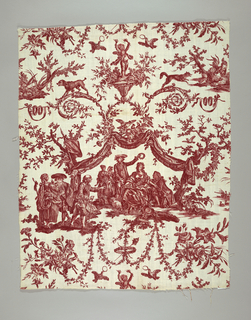 Red and white toile with a scene of a seated woman being crowned with a circlet of roses by a man standing behind her while another man crouches next to her. She is holding a ribbon tied to a sheep. There are two other people behind them, and another group of three stands to the side. The scene is framed by a fringed canopy held by flowering rose vines. Above are acanthus scrolls with dogs and a putto standing on a pediment.