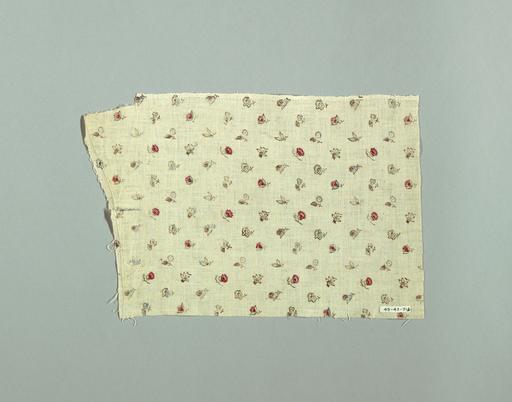 Small scale flowers of eight different kinds printed in brown, red, blue, and light purple on white. Widely spaced all-over design.